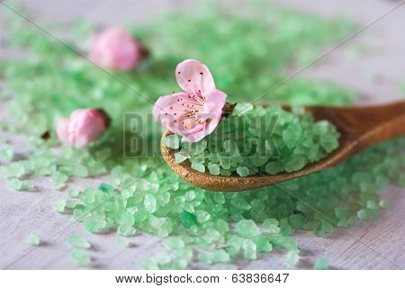Bath On A Wooden Spoon And Spring Flowers