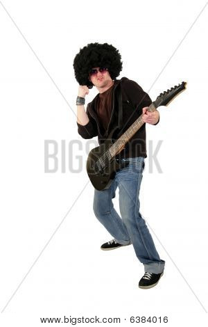 young guitarist with a wig and sunglasses raising his fist