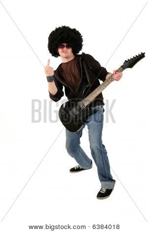 young guitarist showing his middle finger as offensive gesture