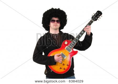 young guitarist with a wig and sunglasses