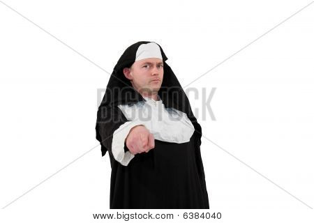 young male actor in a nun´s costume