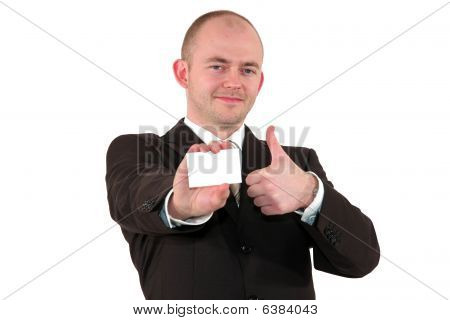 smiling business man showing a business card and posing with the thumbs up sign