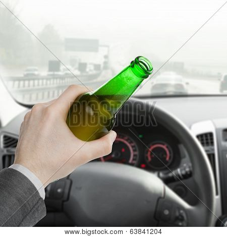 Man Holding Bottle Of Beer In His Left Hand While Driving Car - 1 To 1 Ratio