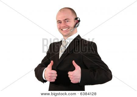 smiling male call center agent posing with thumbs up