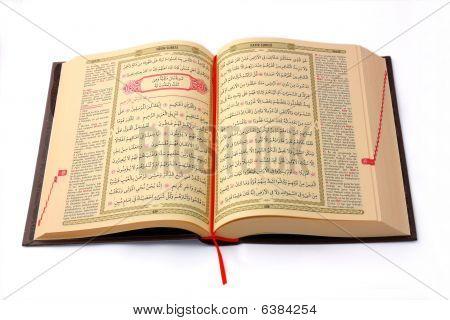 The Holy Koran Opened And Isolated On White Background