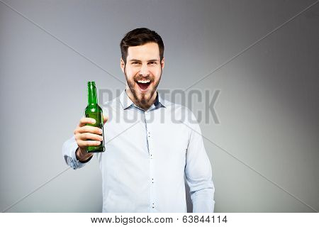 Portrait Of A Smart Serious Young Man Drinking Beer