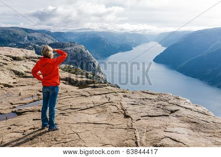 Woman hiker on Pulpit Rock / Preikestolen, Norway