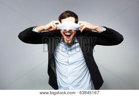 Blindfolded Elegant Man