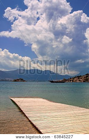 Sea Bay With A Wooden Pier