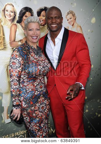 LOS ANGELES - MAR 10:  Terry Crews & Rebecca King-Crews arrives to the Tyler Perry's