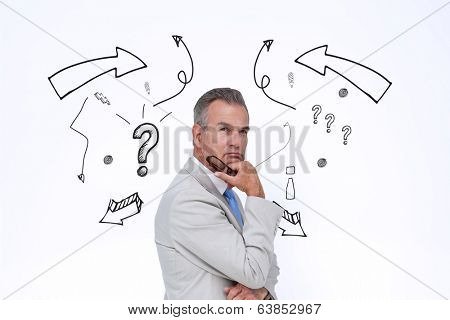 Thinking businessman against idea doodle with arrows