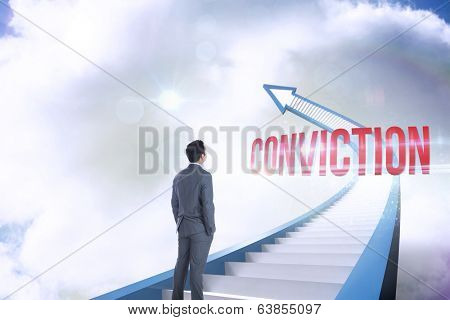The word conviction and businessman standing against red staircase arrow pointing up against sky