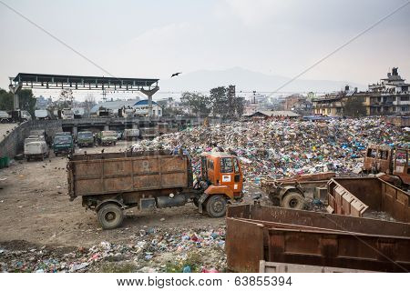 KATHMANDU, NEPAL - DEC 19, 2013: Pile of domestic garbage at landfills. Only 35% population of Nepal have access to adequate sanitation.