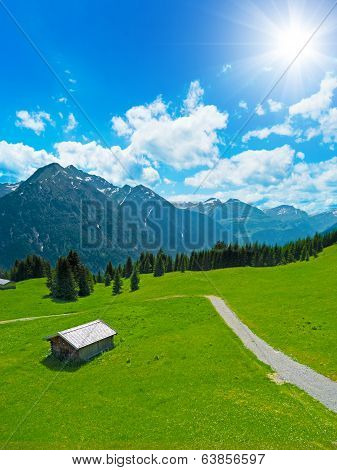 hut and alpine landscape
