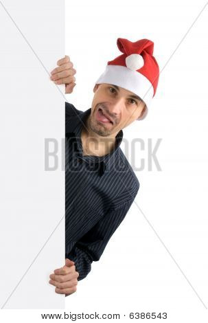 Young Happy Man In A Santa Hat