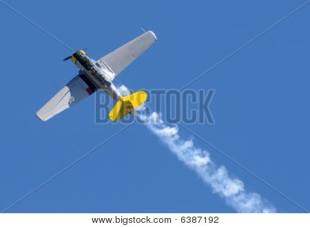 Propeller Airplane With Smoke