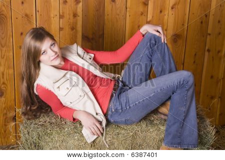 Woman Laying Back Serious On Hay Bale