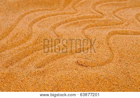 closeup of sand with a swirling pattern