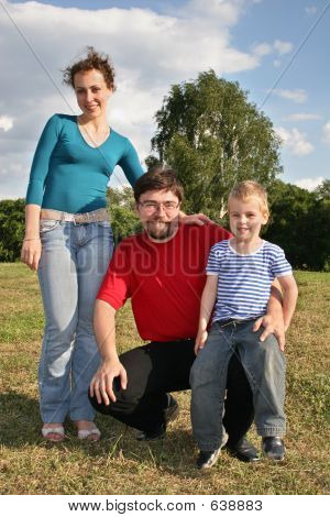 Family With Son Stand On Meadow 2