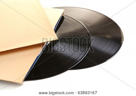 Old vinyl records in paper case, isolated on white