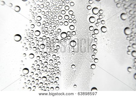 Drops Of Water On The Crooked Glass