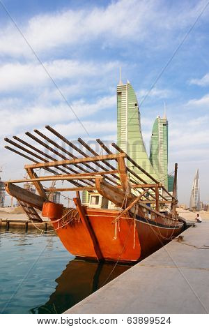 MANAMA, BAHRAIN - FEBRUARY 27, 2009: Manama cityscape with fishermen boat foreground. Bahrain offers visitors a rich history, relaxing beaches and opportunities for fishing and diving.