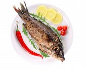 image of plate fish food  - Fried fish on white plate with lemon slices - JPG