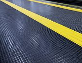 stock photo of slip hazard  - Floor black rubber  - JPG