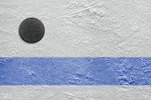 stock photo of hockey arena  - Puck lying on a hockey rink - JPG