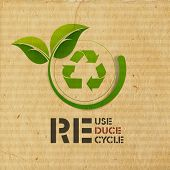 stock photo of environmental protection  - World Environment Day concept with illustration of recycle symbol and green leaves on grungy brown background - JPG