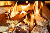 stock photo of firewood  - Close up of firewood burning in outdor fireplace - JPG