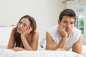 stock photo of not talking  - Unhappy couple not talking after an argument in bed at home - JPG