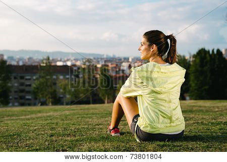 Sporty Woman Taking A Break After Exercising
