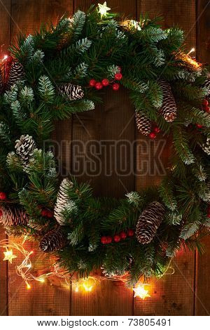 Christmas wreath with firtree cones and garlands