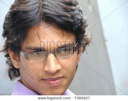a indian close-up face with glasses