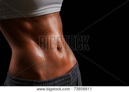 Wet torso of young sporty woman