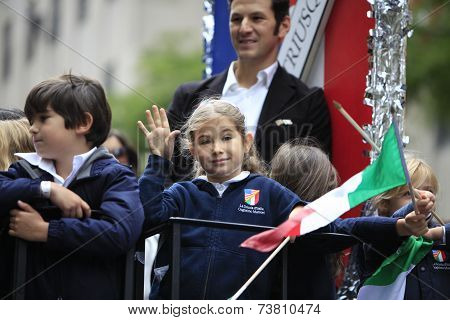 Young float rider waving