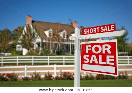 Short Sale Real Estate Sign And House