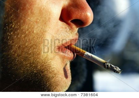 detail of smoking man with cigarette in the mouth
