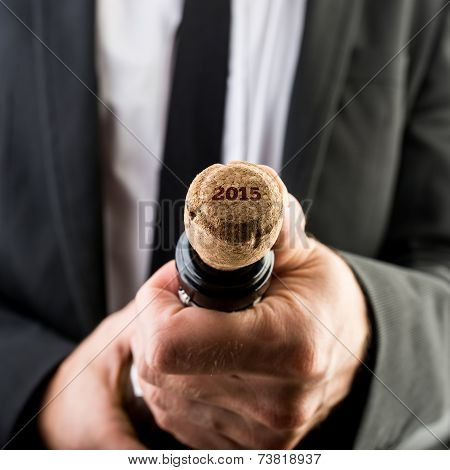 Businessman Opening Wine Bottle With Cork