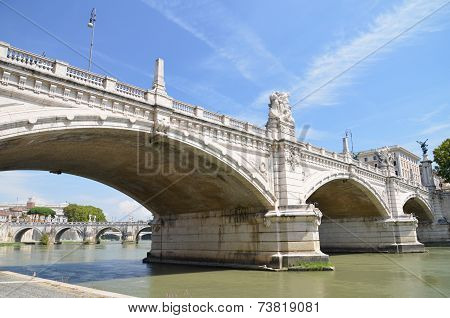 Picturesque view of Vittorio Emanuelle II Bridge over the Tiber river in Rome, Italy