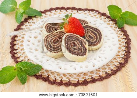 Bolo De Rolo (swiss Roll, Roll Cake) Brazilian Chocolate Dessert  With Strawberry And Mint