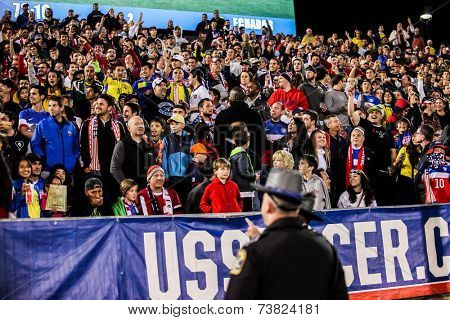 HARTFORD - OCTOBER 10: Security is searching for men who run to Maximo Banguera  on Friendly match between US Men`s National Team vs Ecuador,  on October 10, 2014, in Rentschler Field, Hartford, USA.