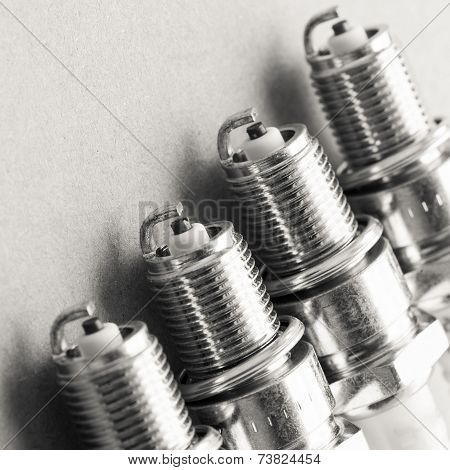 Auto Service. Set Of Spark Plugs As Spare Part Of Car.