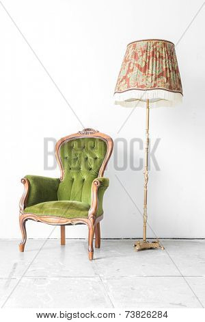 Green classical style Armchair sofa couch in vintage room with desk lamp