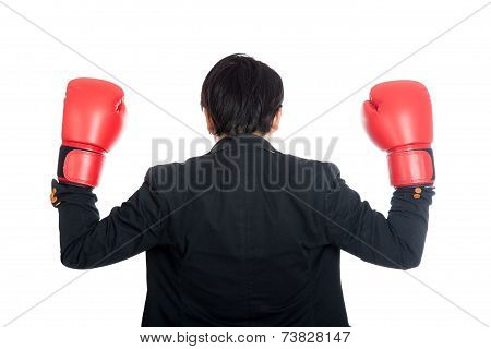 Back Of Asian Businessman Wear Boxing Gloves