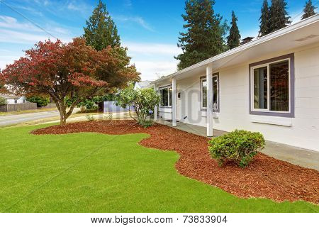 House Exterior With Front Yard Landscape.