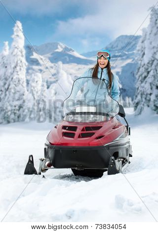 Portrait of woman on snowmobile. Concept of snow sport and healthy lifestyle