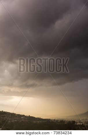 Dark storm clouds over a valley