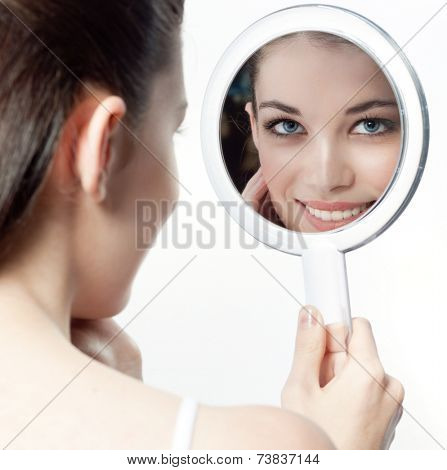 closeup portrait of attractive  caucasian smiling woman brunette isolated on white studio shot lips toothy smile face hair head and shoulders looking at  mirror cleaning face